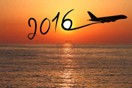 Photo for New year 2016 drawing by airplane on the air at sunset - Royalty Free Image
