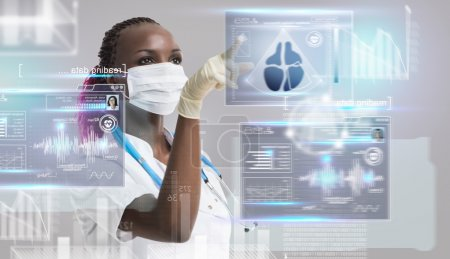 Doctor working with computer interface
