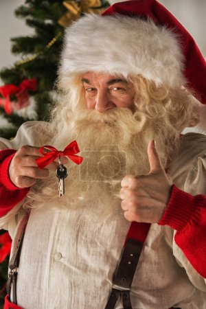 Santa Claus holding keys of new house