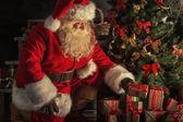 Santa is placing gift boxes