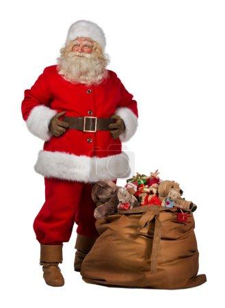 Santa Claus posing near a bag