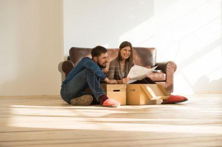 Photo for Young couple moving in new house - Royalty Free Image