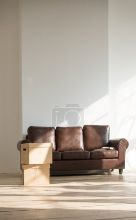 Sofa and cardboard boxes