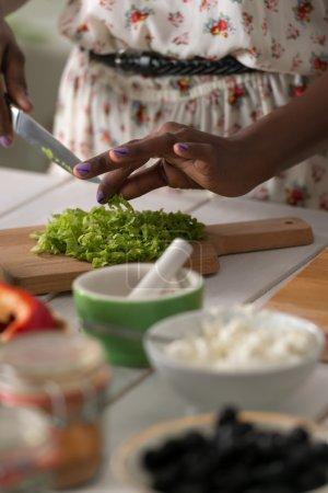 African Woman preparing Salad
