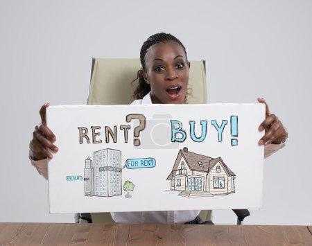 Photo pour African businesswoman with Mortgage concept sign - image libre de droit