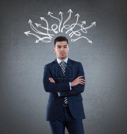 Businessman with drawn arrows