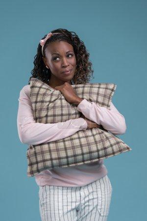 Woman embracing pillow