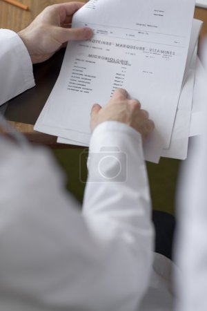 Doctor working with test results