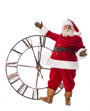 Photo for Full length Santa Claus posing with big watches isolated on white background. - Royalty Free Image