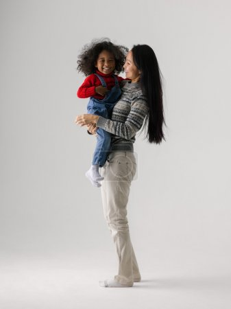 Photo for Mixed race mother and daughter playing together - Royalty Free Image