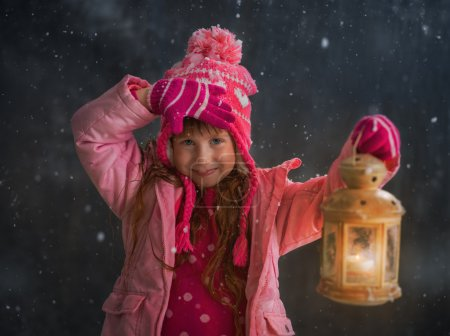 Girl with lantern under Snow