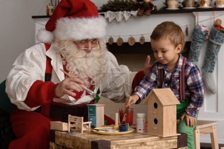 Santa Claus with Child making Toys