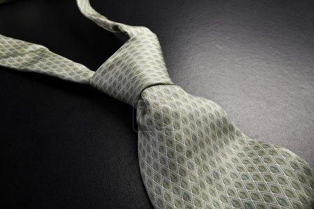 Elegant gray tie on a black