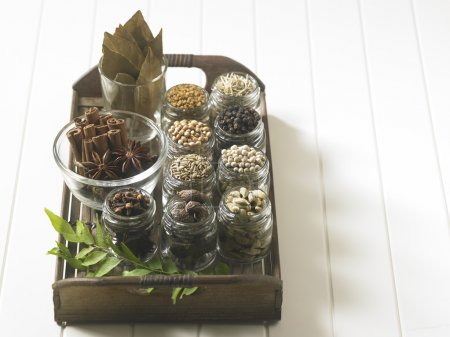 Photo for Assorted spices on the bamboo tray - Royalty Free Image