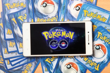 Smartphone and cards with pokemon go