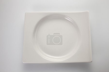 Photo for Top view of a  White plate on the white background - Royalty Free Image