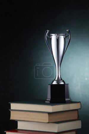 Silver goblet on books