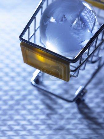 Glass globe on shopping cart.
