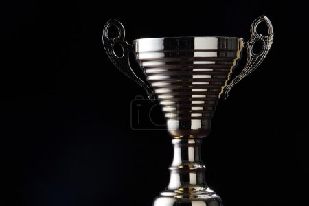 Silver color trophy on the black