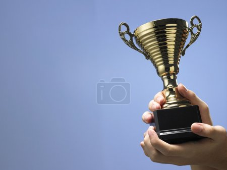 Man holding trophy close up