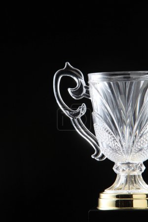 Glass trophy on the black