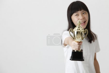 girl holding trophy