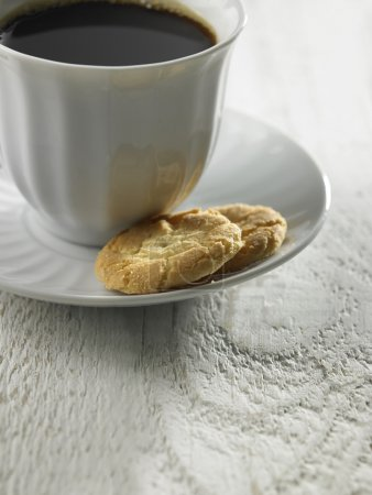 Black coffee with two biscuits