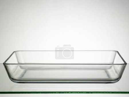 Photo for Glass rectangular bowl on top of glass table - Royalty Free Image
