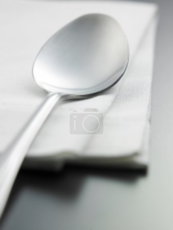 Spoon on the napkin on table