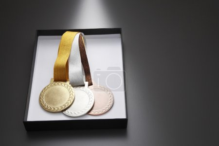 Tree medals in a box