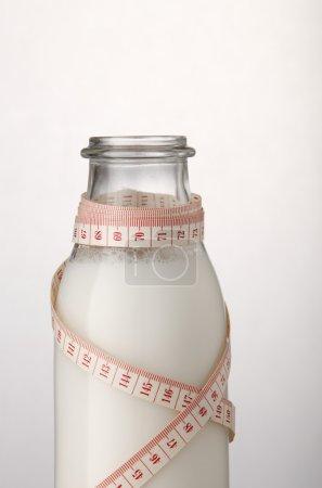 Fresh milk and measuring tape