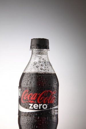 A bottle of Coca Cola drinks