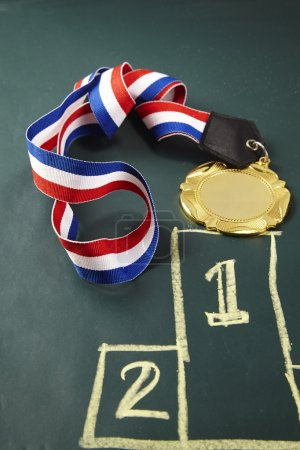 sport medal on the blackboard
