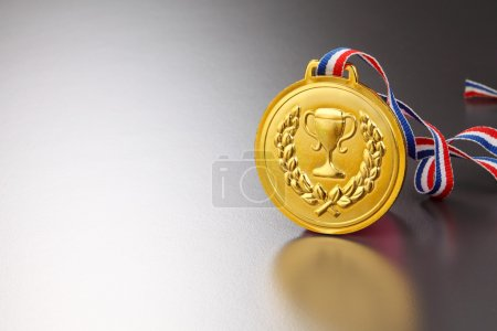 golden medal with trophy