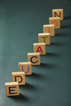 Photo for Wooden square blocks abc on the blackboard - Royalty Free Image
