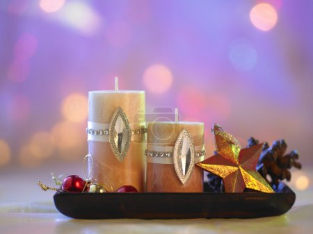 Photo for Decorative christmas candles on blurred background - Royalty Free Image