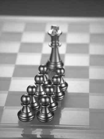 Metal chess king and pawns