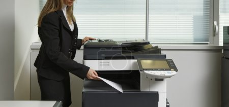 Photo for Italy, italian girl using Xerox machine in an office - Royalty Free Image