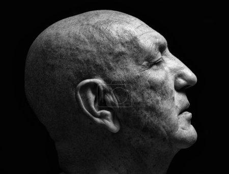 studio portrait of a bald old man
