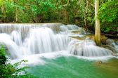 Amazing Thailand waterfall in autumn forest