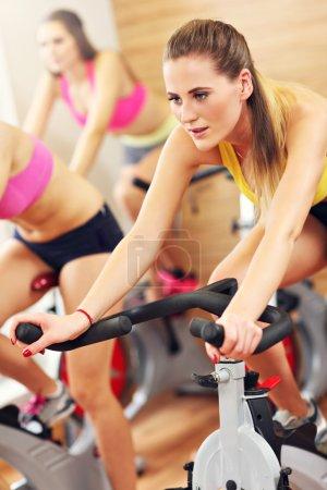 Sporty women on spinning class