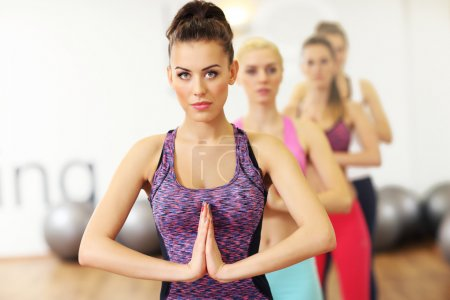 Photo for Picture of women group doing yoga in gym - Royalty Free Image
