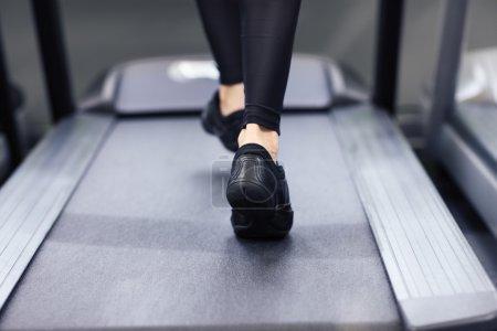 Female Legs on treadmill