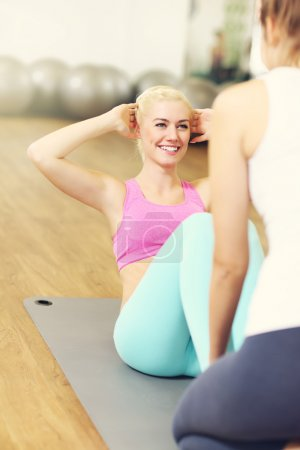 Photo for Picture of fit woman doing sit ups in gym - Royalty Free Image