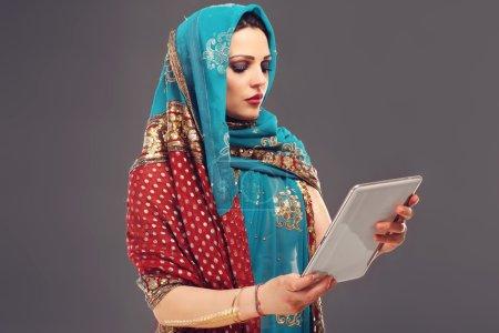 Arabic woman using tablet