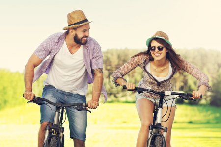Photo for Picture of romantic couple riding bikes - Royalty Free Image
