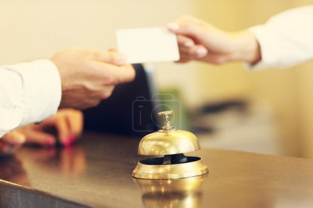 Guests getting key card in hotel