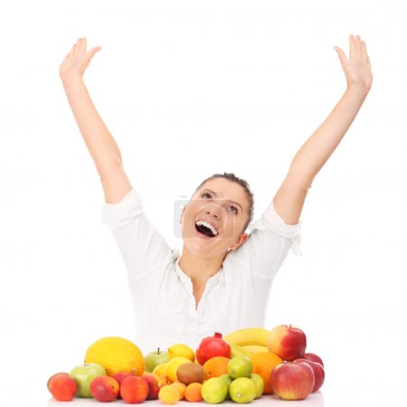 Photo for A picture of a happy woman with fruits over white background - Royalty Free Image