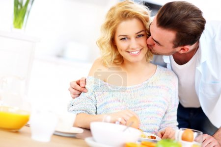 Man giving good morning kiss
