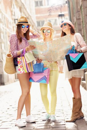 Group of girl friends using map